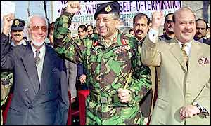 General Musharraf raises a fist with leaders of Pakistan-administered Kashmir