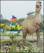 A giant dinosaur stands guard at the park