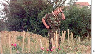 A British soldier at the site of a mass grave in Kacanik, Kosovo
