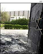 The charred remains of a synagogue door