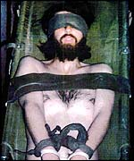 John Walker Lindh's lawyers released this picture saying it showed him in military custody, strapped to a stretcher and blindfolded