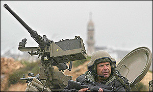 Israeli soldier at entrance to West Bank city of Ramallah
