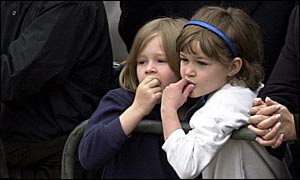 Children watch the Queen Mother's hearse
