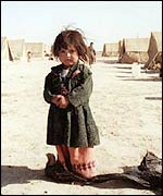 Afghan refugee child in a desolate camp on the Iranian border