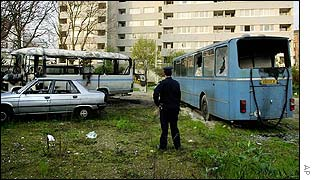 Two burnt out buses belonging to a Jewish school
