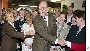 Mr Chirac and his wife Bernadette shake hands with supporters