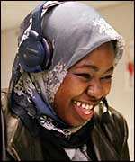 Woman with headset laughing
