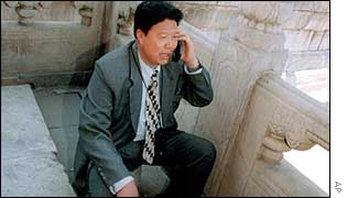 Chinese man taking phone call