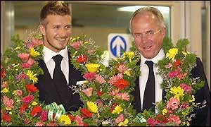 David Beckham and Sven-Goran Eriksson are welcomed with flowers as they arrive in South Korea
