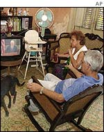 A Cuban family watches Jimmy Carter's historic speech on Cuban television