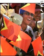 East Timorese wave the new national flag