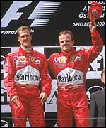 Schumacher pulled Barrichello onto the top step of the podium after being let through into the lead feet from the finish line