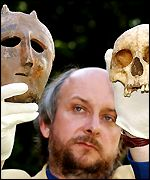 Senior archaeologist Peter Wilson with the skull and mask of the priest