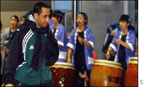 Saudi striker Sami Al-Jaber is greeted by Japanese drummers at a welcoming reception