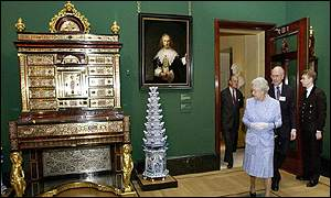 The Queen inspects a recently restored Rembrandt and a Boulle secretaire