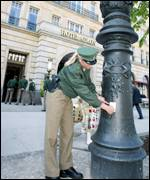 German policemen checks old lamp in front of Mr Bush's hotel