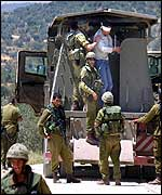 Israeli troops with detainees outside Salfit