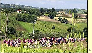 The pack of cyclists pedal through the countryside during stage ten