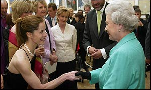 Ballerina Darcey Bussell curtsies in front of the Queen