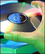CD being placed in computer, Eyewire