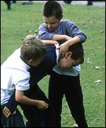 Children play-fighting