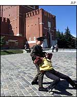 A Kremlin guard tackles a protester in Red Square