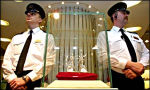 Guards watching over a pair of platinum and diamond-encrusted shoes