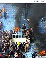 Football fans riot in Xian, March 2002