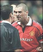 An angry Roy Keane confronts a referee