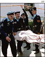 Police carry the injured away from the scene of the blast