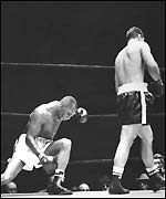 Rocky Marciano walks away from Jersey Joe Walcott