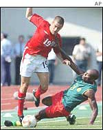 England's Joe Cole skips over a challenge