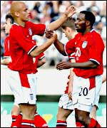 Wes Brown celebrates with scorer Darius Vassell