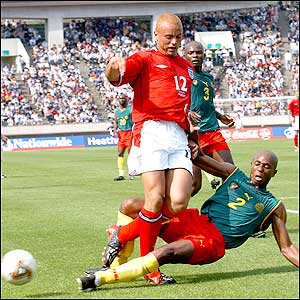 Bill Tchato slides in on Wes Brown