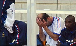 Zinedine Zidane holds his head in his hands after tearing his thigh on Sunday