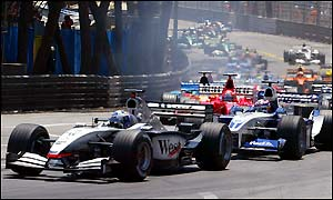 David Coulthard leads Juan Pablo Montoya and Michael Schumacher on the first lap