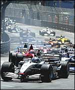 David Coulthard leads at the first corner of the Monaco Grand Prix