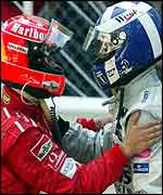 Michael Schumacher congratulates David Coulthard