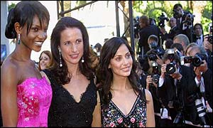 South African model Primerose Moloantoa (left), American actress Andie MacDowell and Australian singer Natalie Imbruglia