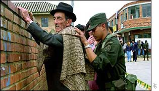 Soldier searches voter in La Calera, Bogota