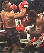 Mike Tyson batters Frank Bruno against the ropes in 1996