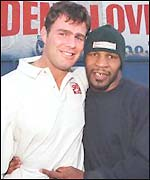 Mike Tyson poses with former world cruiserweight champ Glenn McCrory