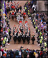The Queen's carriage is escorted by the Household Cavalry Mounted Regiment down the Royal Mile in Edinburgh