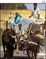Villagers leave the Jammu area