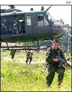 Colombian police secure a field after landing near Popayan