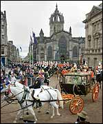 The Queen and Duke of Edinburgh travel to the horse-drawn Scottish State Coach to the opening of the General Assembly of the Church of Scotland in Edinburgh