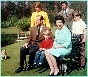 Prince Phillip and Queen Elizabeth sit with all their children and a couple of corgis