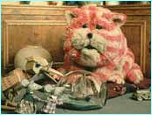 A cloth cat called Bagpuss hit UK screens - shown here with Professor Yaffle