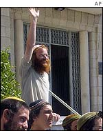 Supporters of accused settlers