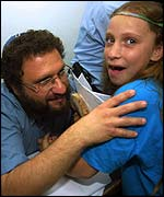 Noam Federman with his daughter in court